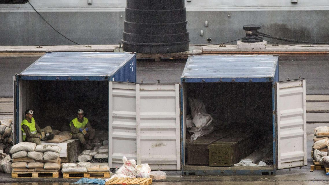 Israeli soldiers sit on crates said to contain M-302 rockets that were unloaded from the Panamanian-flagged Klos-C vessel on March 9, 2014 in the southern Israeli port of Eilat.