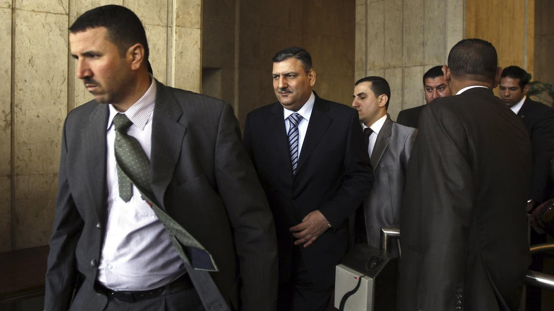 Former Syrian Prime Minister Riyad Hijab (2nd L) leaves the Egytian Foreign ministry after meeting Egyptian Foreign Minister Mohamed Kamel Amr in Cairo February 11, 2013.