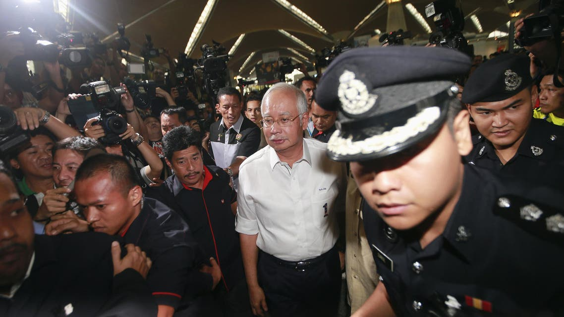 Malaysia's Prime Minister Najib Razak (C) arrives at the holding area for family and friends of passengers aboard missing Malaysia Airlines flight MH370 reuters