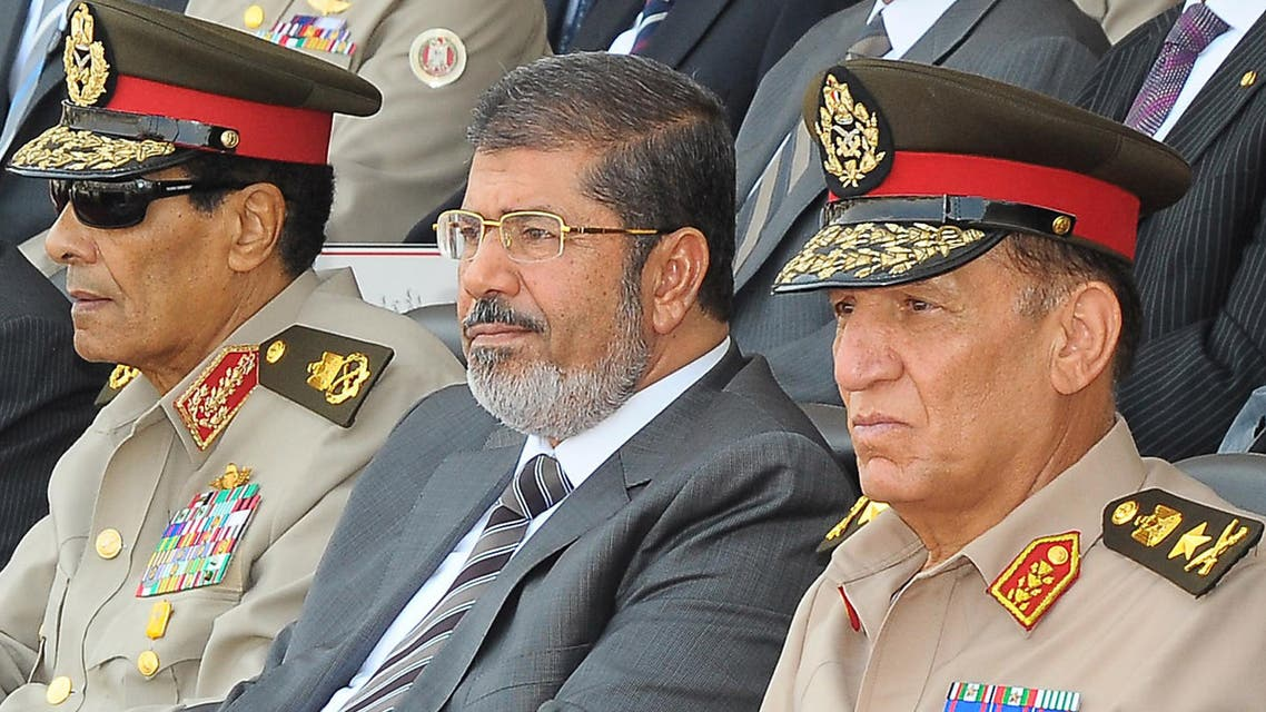 Former armed forces chief Sami Anan, right, with ousted President Mohammad Mursi, center, and former defense minister Mohammed Hussein Tantawi, left, attending a graduation ceremony of military cadets in Cairo. (File Photo: AFP)