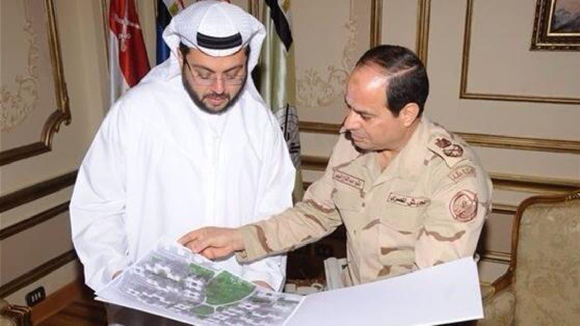 Egypt's Field Marshal Abdel Fattah al-Sisi and Hasan Abdullah Ismaik, chief executive of Arabtec, review development plans. (Image courtesy: Arabtec)