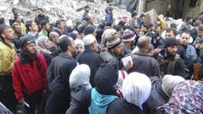 Hunger as a weapon of war: Yarmouk Syrians 'eat cats and dogs'