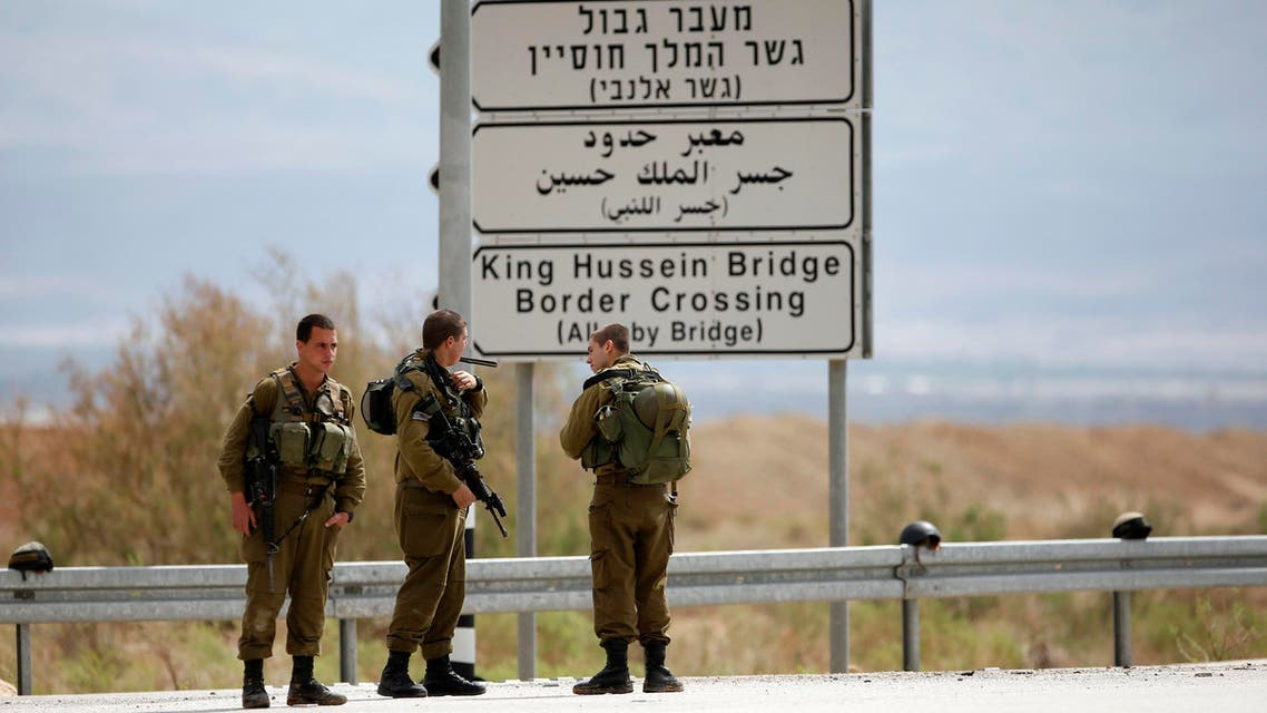 Israeli soldiers stand guard near the entrance to Allenby Bridge, a crossing point between Jordan and the occupied West Bank, reuters