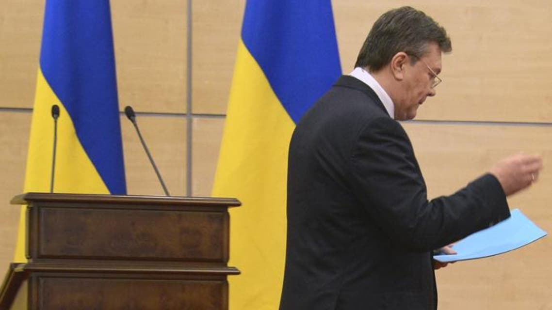 Deposed Ukrainian president Viktor Yanukovych walks as he attends his press-conference in southern Russian city of Rostov-on-Don, on March 11, 2014. (Reuters)