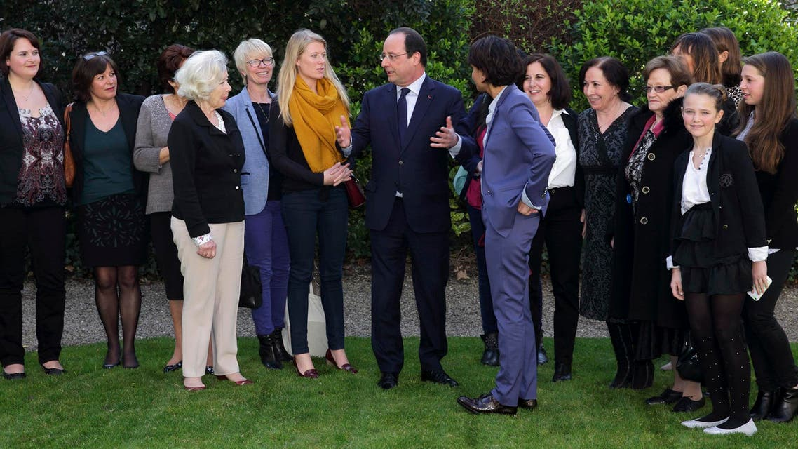 French President Francois Hollande and Minister of Women's Rights and Spokesperson of the Government Najat Vallaud-Belkacem (8th L) speak with women from four generations after a meeting in Paris, March 8, 2014. (Reuters)