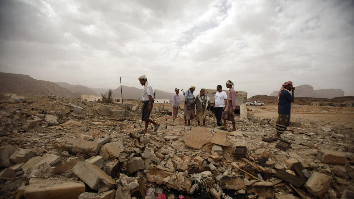 Tribesmen stand on the rubble of a building destroyed by a U.S. drone air strike. (File photo: Reuters)