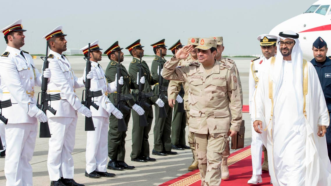 Abu Dhabi's Crown Prince Sheikh Mohammed bin Zayed al-Nahyan (R) and Egypt's army chief Field Marshal Abdel Fattah al-Sisi (2nd R) review the honor guard upon Sisi's arrival to Abu Dhabi March 11, 2014.