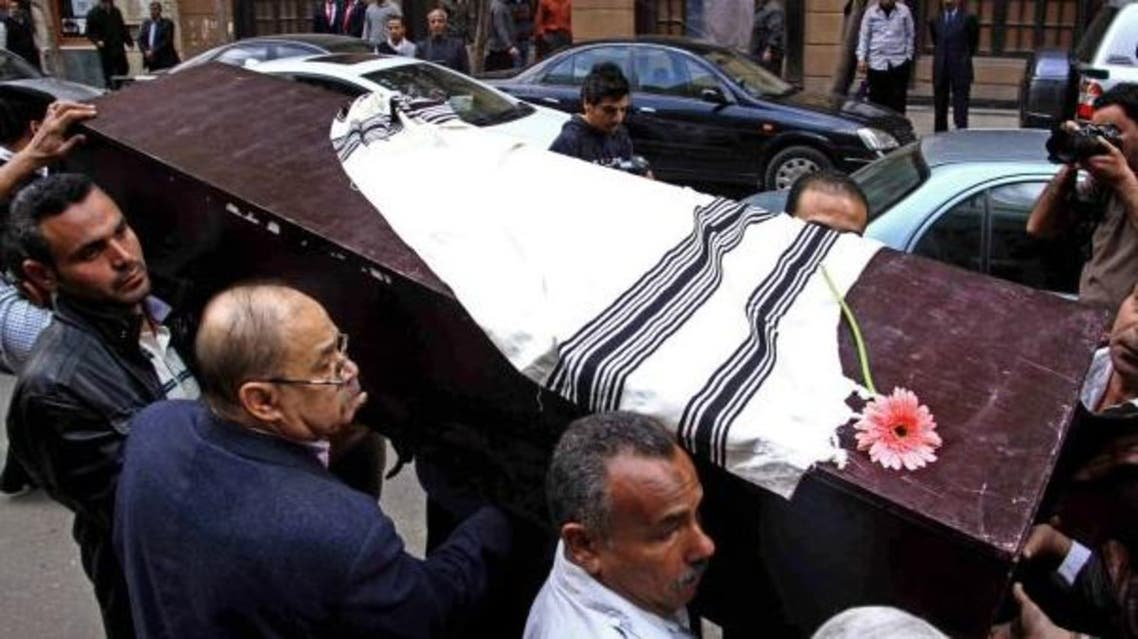 Egyptians carry the coffin of Nadia Haroun, the deputy head of the dwindling Jewish community, outside the Jewish synagogue, Shaar Hashamayim, in Cairo, Egypt on Tuesday, March 11, 2014.