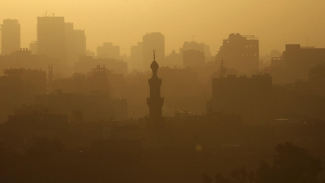 The sun sets over the minarets of mosques and houses amidst fog in the old town of Cairo on Sept. 4, 2013. (File photo: Reuters)