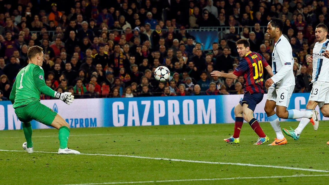 Barcelona's Lionel Messi (C) scores a goal past Manchester City's goalkeeper Joe Hart during their Champions League last 16 second leg soccer match at Camp Nou stadium in Barcelona March 12, 2014. (Reuters)