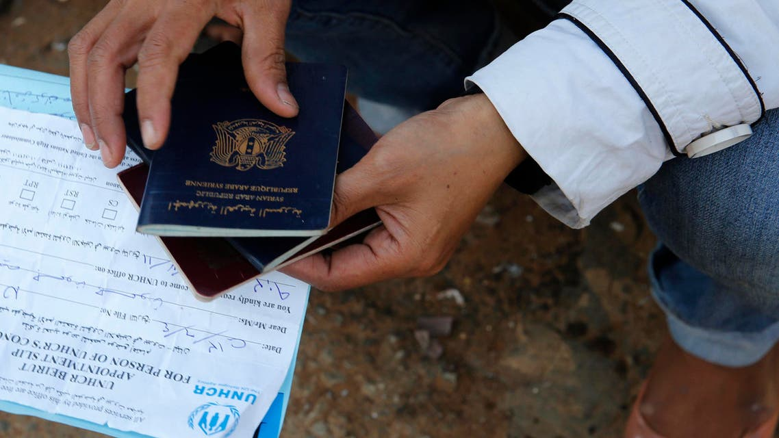 syria passport reuters
