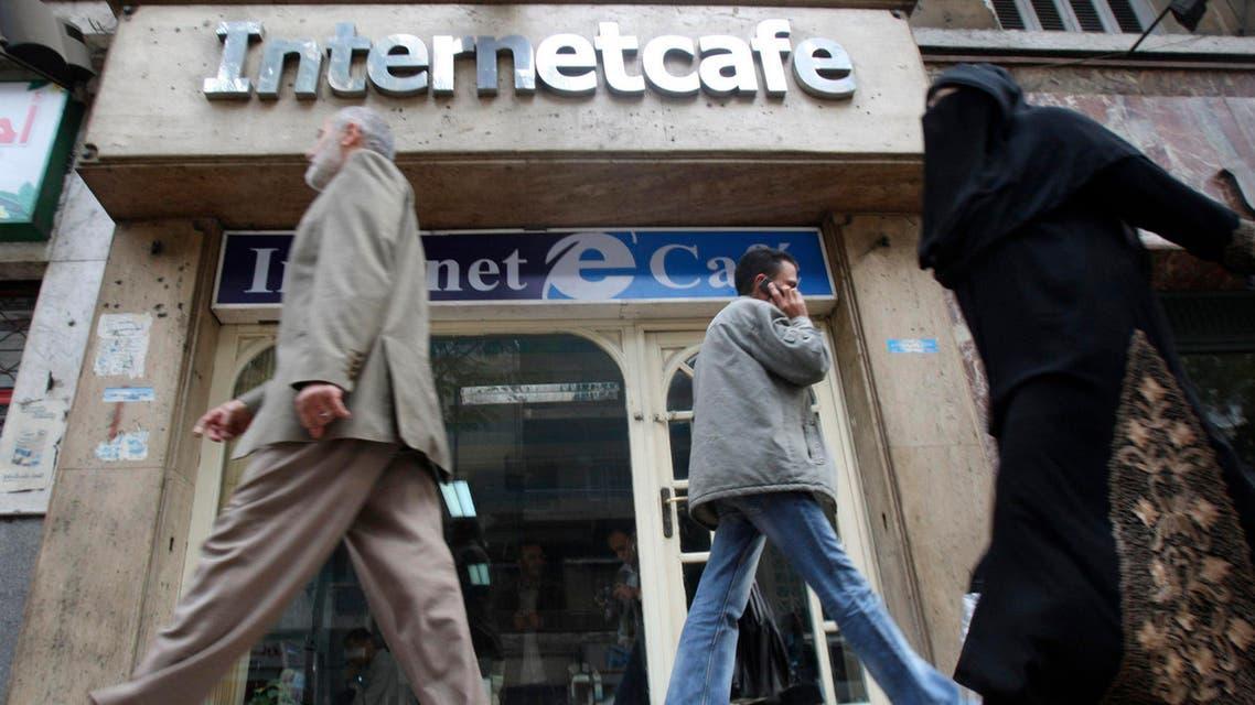 People walk past a web cafe in Cairo in Dec, 20, 2008. A few years later, the internet was used in organizing protests against the then president. (File photo: Reuters)