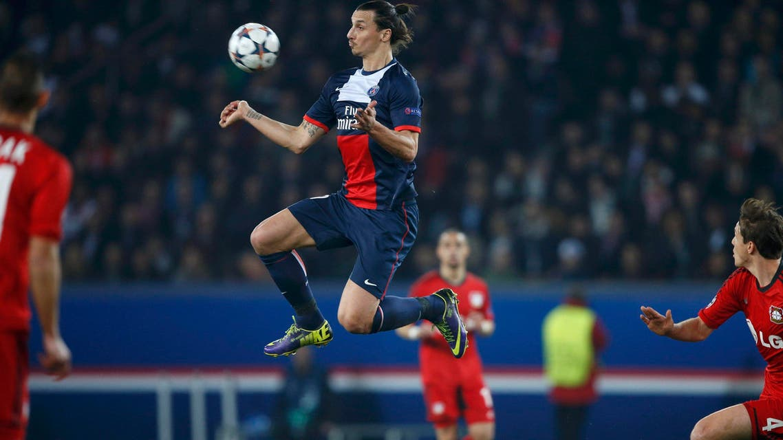 Paris St Germain's Zlatan Ibrahimovic (C) controls the ball during their Champions League round of 16 second leg soccer match against Bayer Leverkusen at the Parc des Princes Stadium in Paris, March 12, 2014. (Reuters)