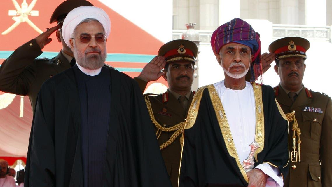 السلطان قابوس خلال استقبالة روحاني