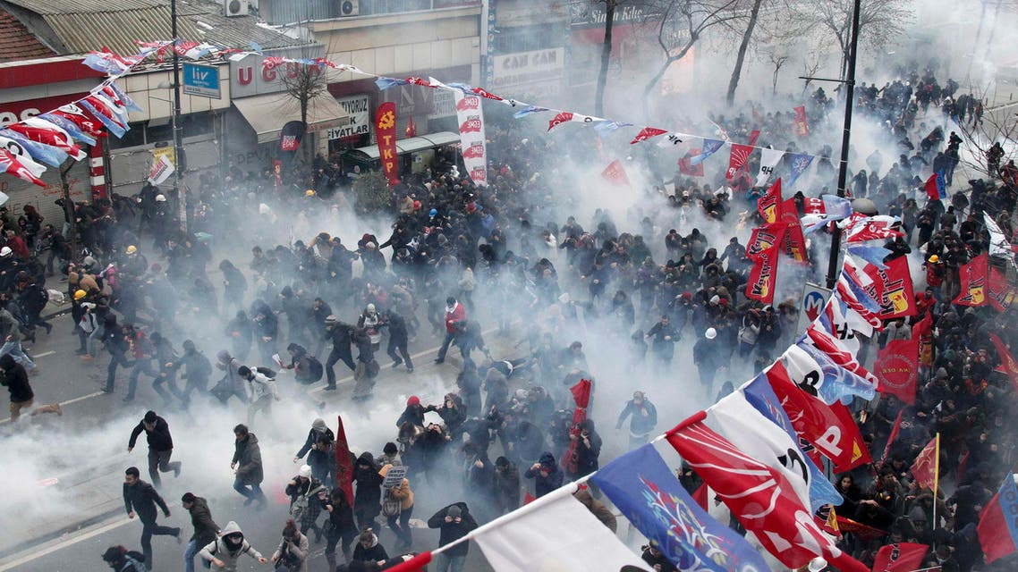 Anti-government protesters run as riot police fires tear gas during a demonstration in Istanbul March 12, 2014. reuters