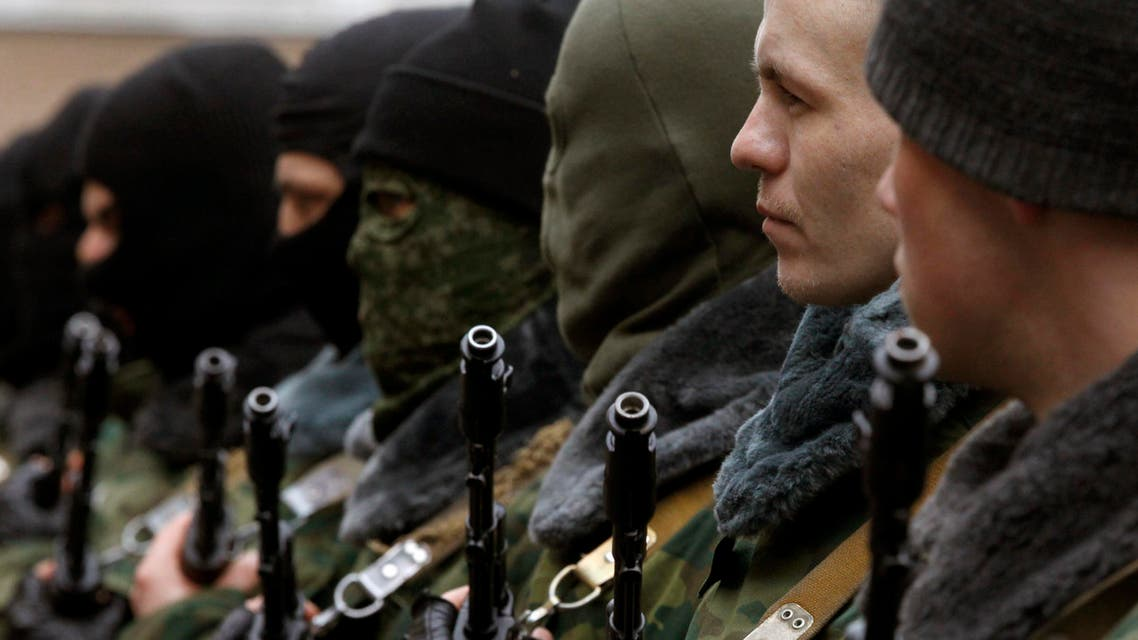 Members of a pro-Russian self defence unit stand in formation as they take an oath to Crimea government in Simferopol March 10, 2014. (Reuters)