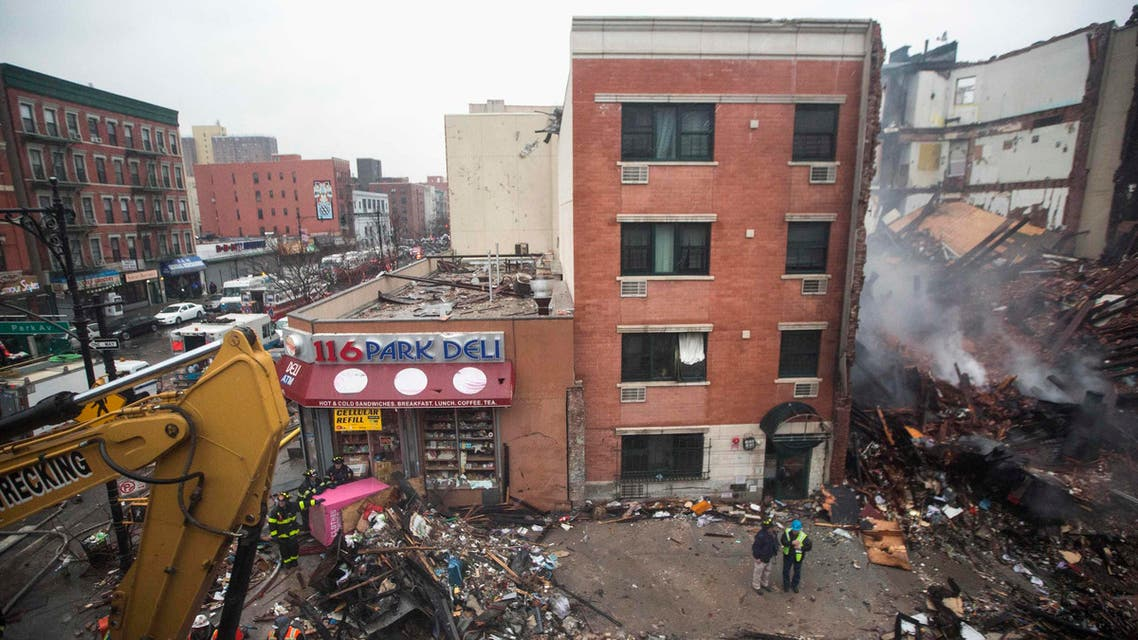 New York City emergency responders work at the site of an explosion and collapse of two buildings in the Harlem section of New York, March 12, 2014.  (Reuters)