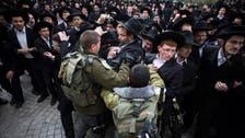 Israeli MPs pass law to conscript ultra-Orthodox Jews