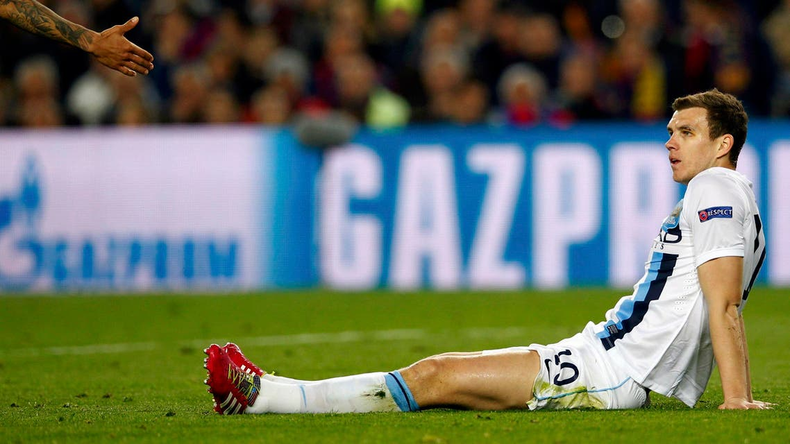Manchester City's Vincent Kompany reacts during their Champions League last 16 second leg soccer match against Barcelona at Camp Nou stadium in Barcelona March 12, 2014. (Reuters)
