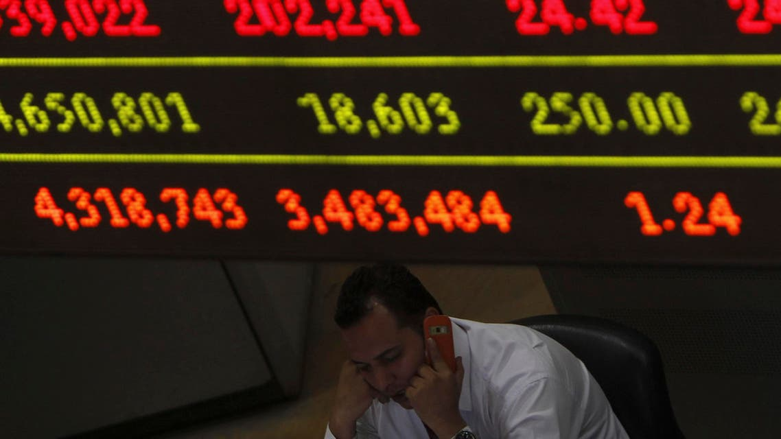 A trader speaks on his mobile phone next to a stock index board at the Egyptian Stock Exchange in Cairo on June 7, 2012. (File photo: Reuters)