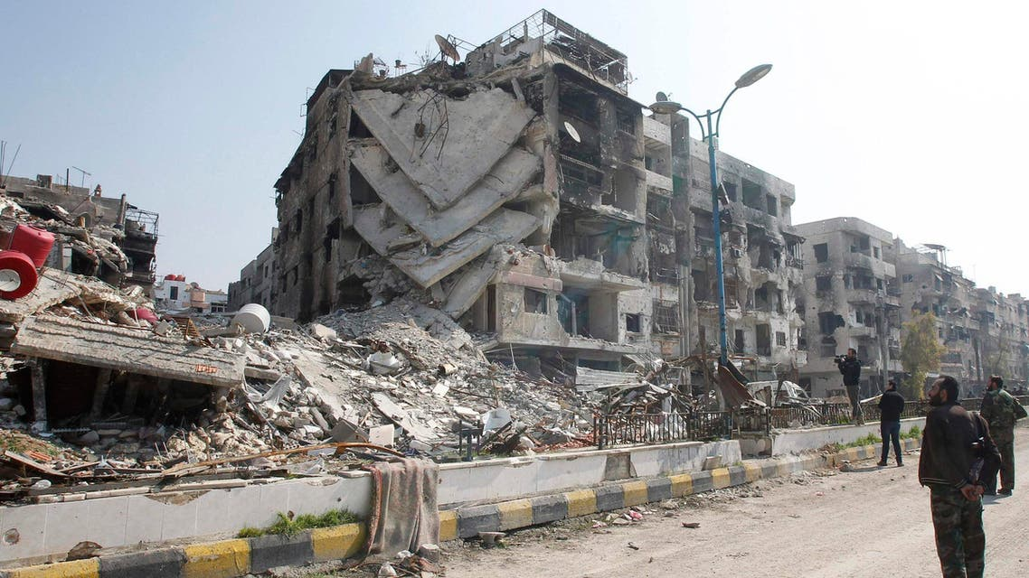 A damaged building is pictured in Babila town, southeast Damascus in this February 17, 2014 file photo. (Reuters)