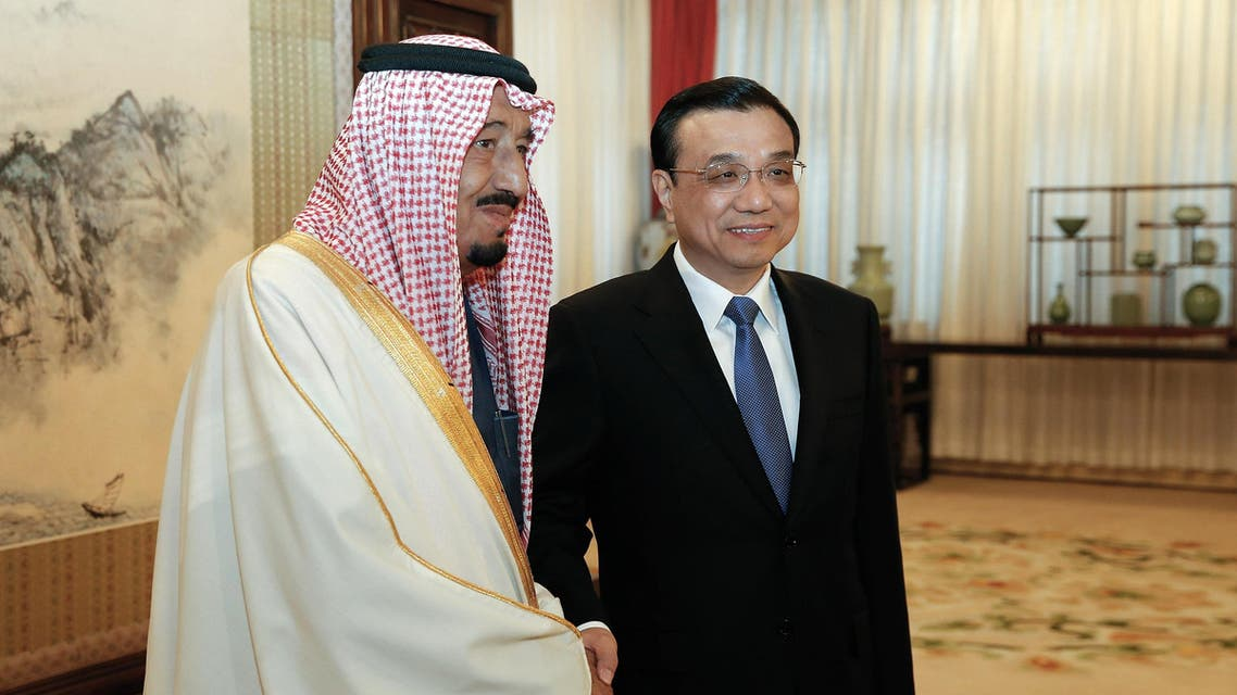 Chinese Vice Premier Li Keqiang (R) shakes hands with Saudi Arabian Crown Prince Salman bin Abdulaziz (L) at the Ziguangge Pavilion in the Zhongnanhai leaders' compound in Beijing on March 14, 2014. (AFP)