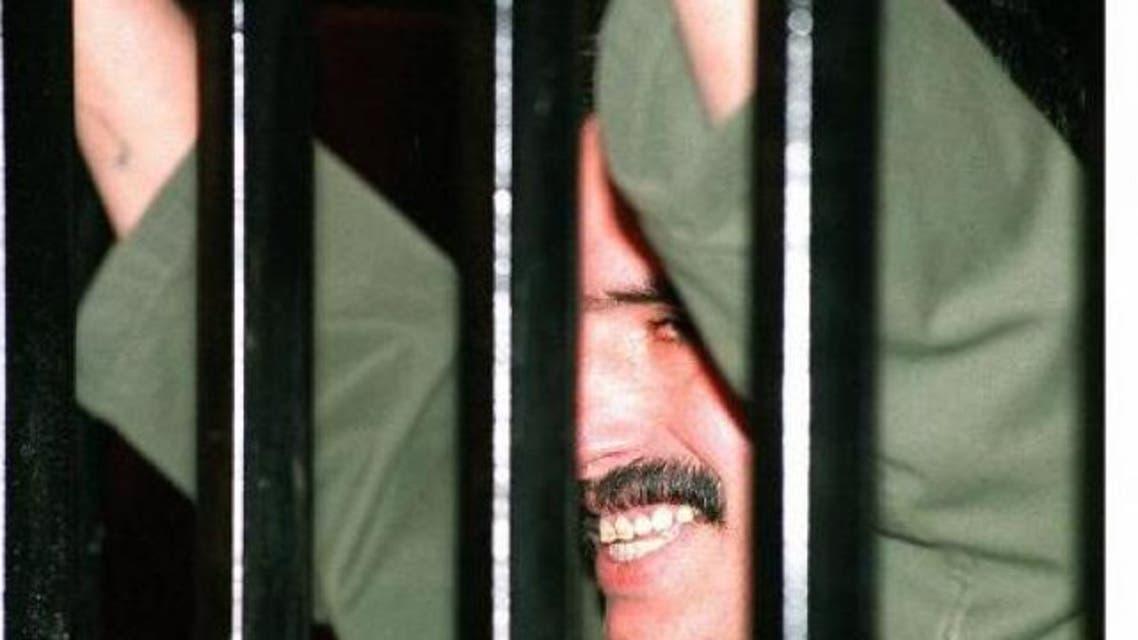 Jordanian soldier Ahmad Dakamseh, who shot dead seven Israeli schoolgirls, is seen behind bars at a military court in Amman on May 27, 1997. (File photo AFP)