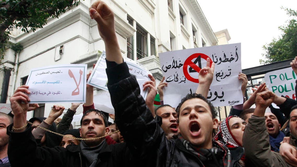 Protesters shout slogans during a demonstration against Algerian President Abdulaziz Bouteflika's decision to run for a fourth term, in Algiers March 15, 2014. (Reuters)