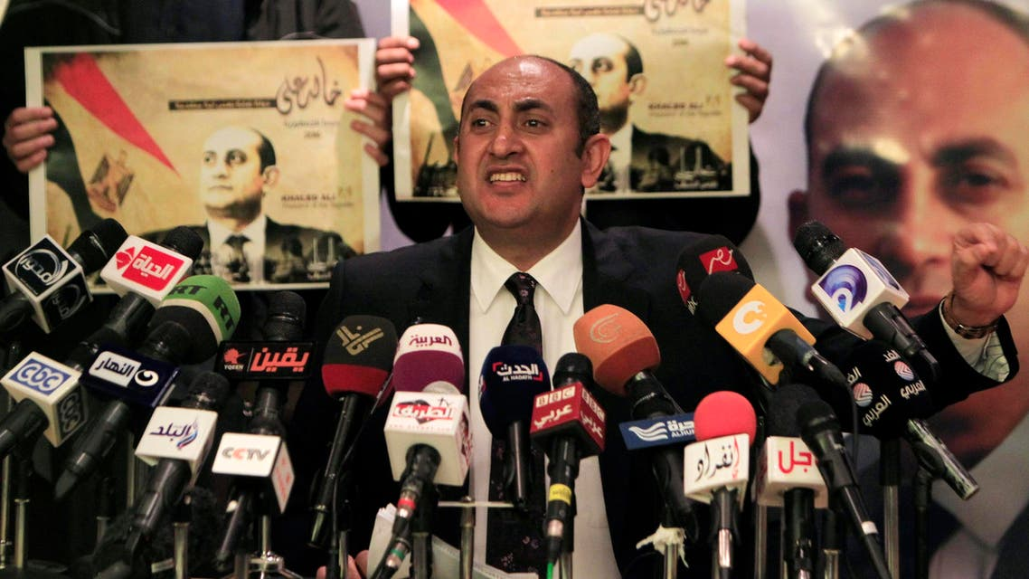 Egypt's leftist activist and labor rights lawyer Khaled Ali gestures during a news conference in Cairo, March 16, 2014. Reuters