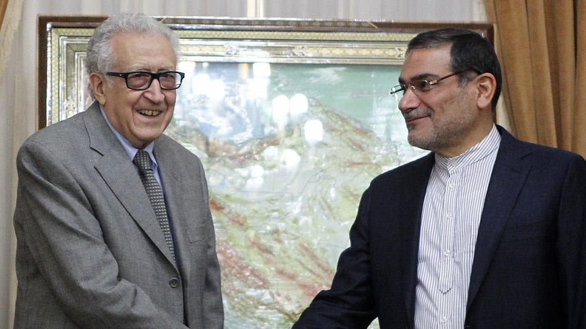 UN-Arab League Special Envoy for Syria Lakhdar Brahimi (L) shakes hands with Iranian secretary of the Supreme National Security Council, Ali Shamkhani in Tehran on March 16, 2014. (AFP)