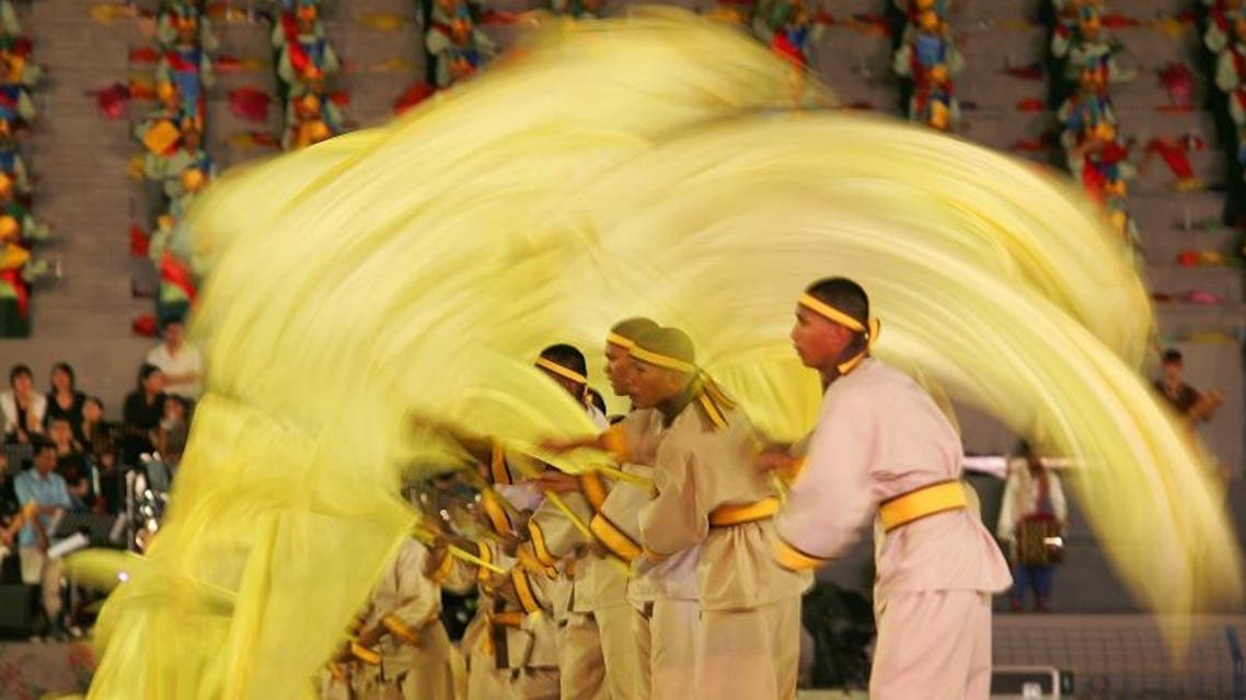 Dancers perform Malaysian traditional dance during a full dress rehearsal for the Colors of Malaysia 2005 parade in Kuala Lumpur. (Reuters)