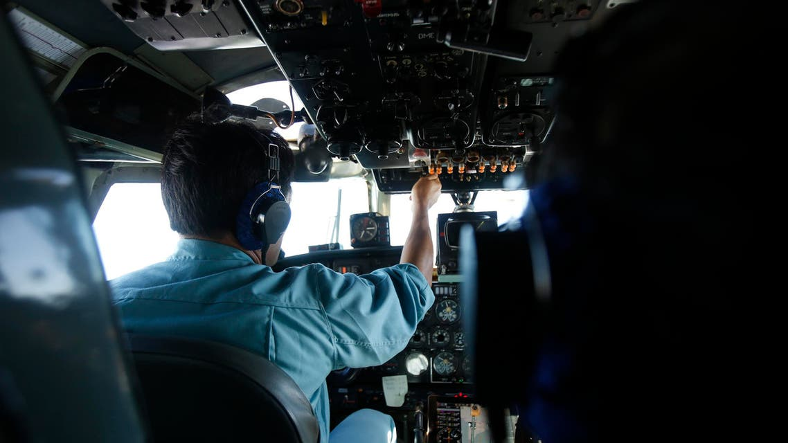 Military officer and pilot Hoang Van Phong works within cockpit of a Vietnam Air Force AN-26 aircraft during a mission to find the missing Malaysia Airlines flight MH370, off Con Dao island March 13, 2014. reut