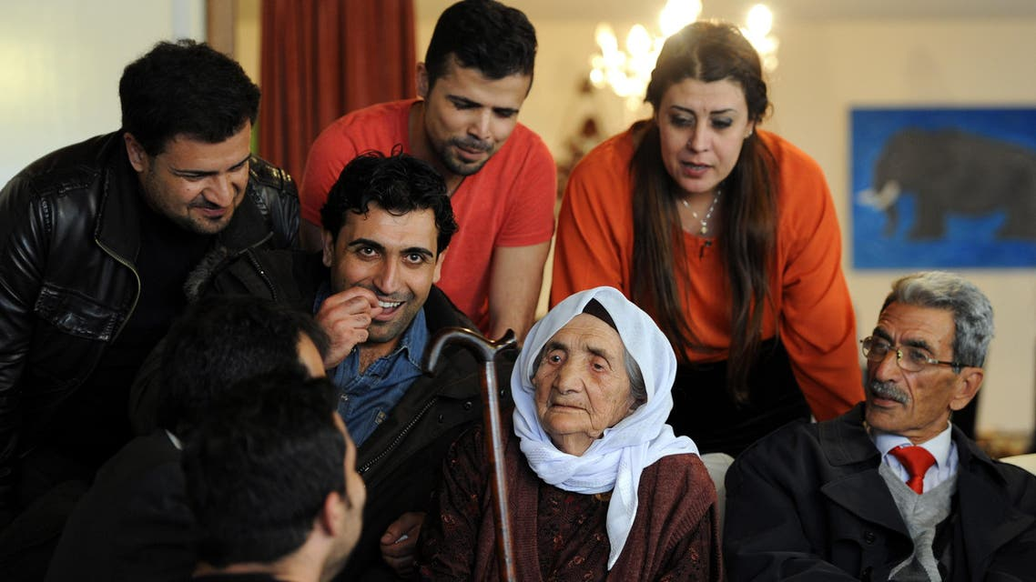 Sabria Khalaf (C), 107 years old Syrian refugee, is pictured at her family house in Holdorf, Germany, on March 17, 2014. Khalaf was welcomed by family members who are already living in Germany. (AFP)