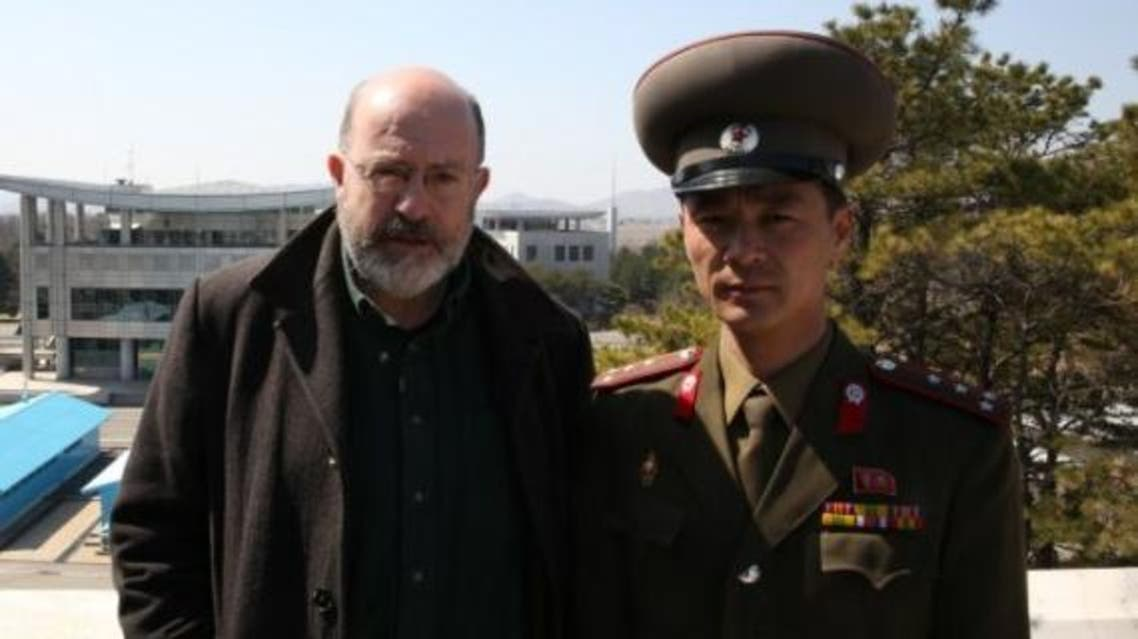 The BBC's John Sweeney poses with a North Korean soldier. (Image courtesy: BBC)