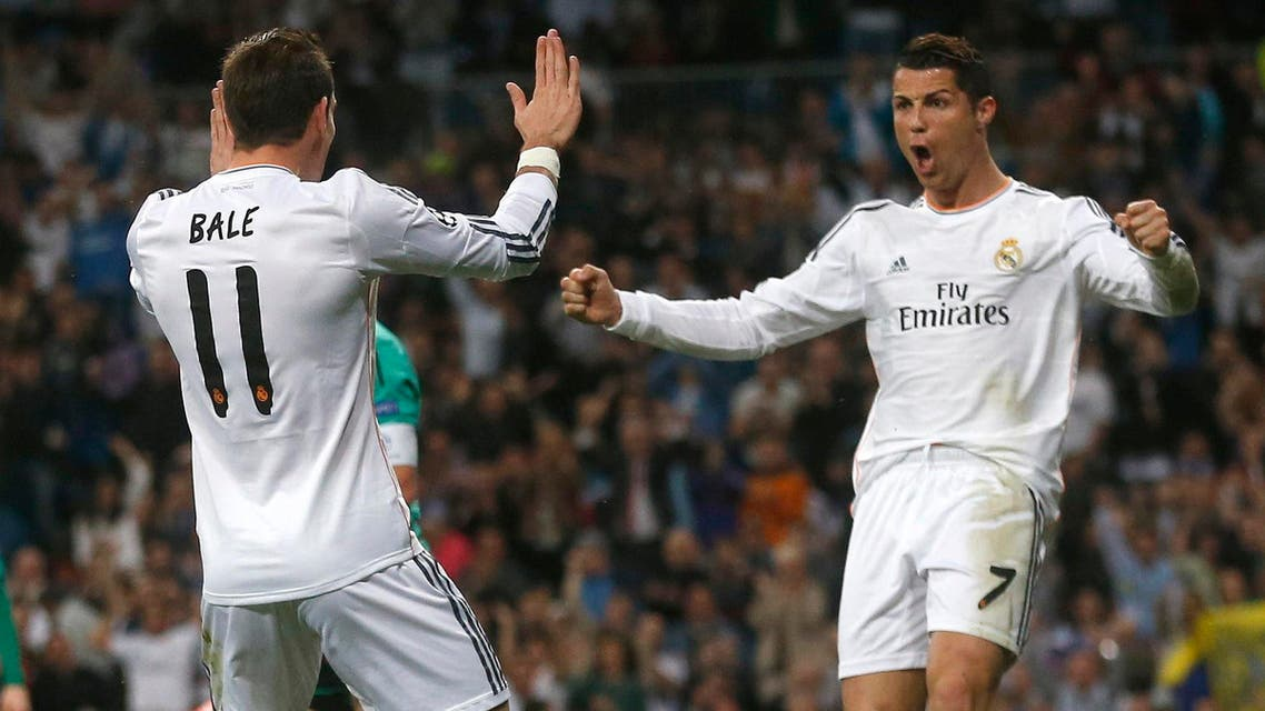 Real Madrid's Cristiano Ronaldo (R) celebrates with teammate Gareth Bale after scoring a goal against Schalke 04 at Santiago Bernabeu stadium in Madrid March 18, 2014. (Reuters)