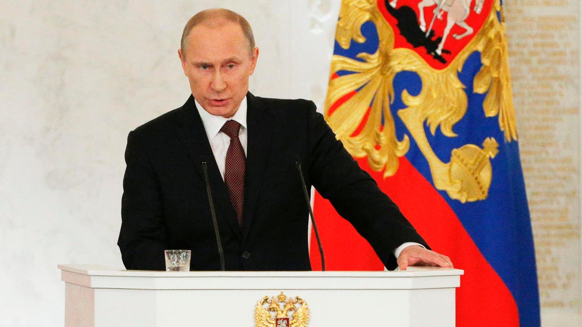 Russian President Vladimir Putin addresses the Federal Assembly, including State Duma deputies, members of the Federation Council, regional governors and civil society representatives, at the Kremlin in Moscow March 18, 2014. reut