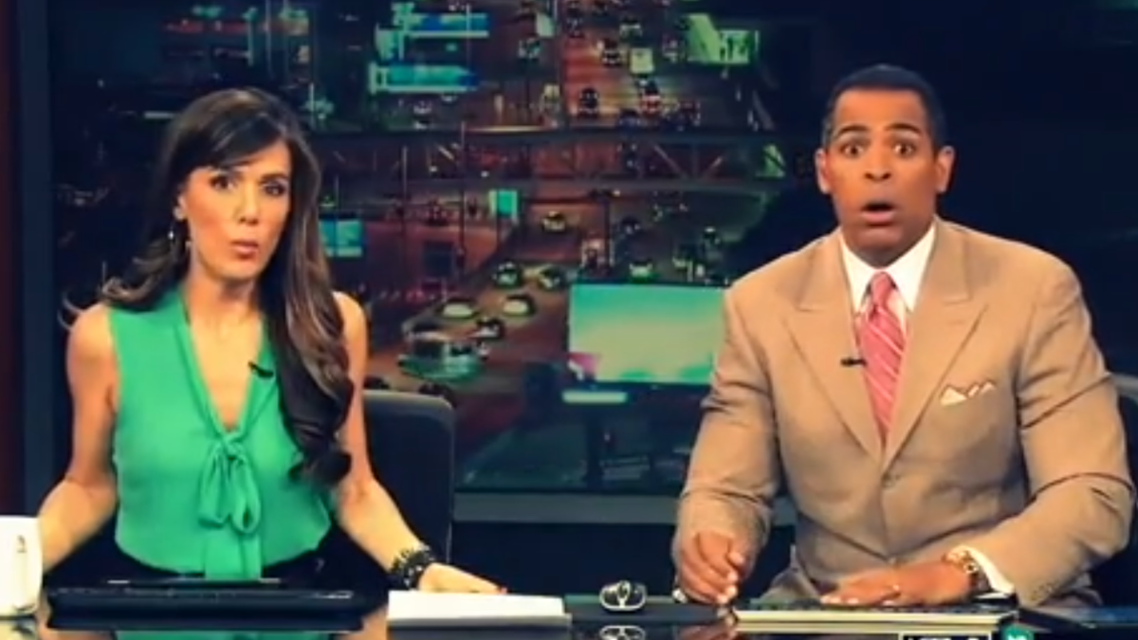 Anchors Chris Schauble and Megan Henderson hid under their desk during Monday's quake. (Image courtesy: KTLA-TV)