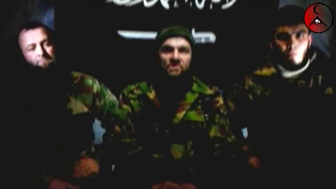 An undated still image taken from video shows the address of Chechen rebels, led by Emir of the Caucasus Doku Umarov (C). (Reuters)