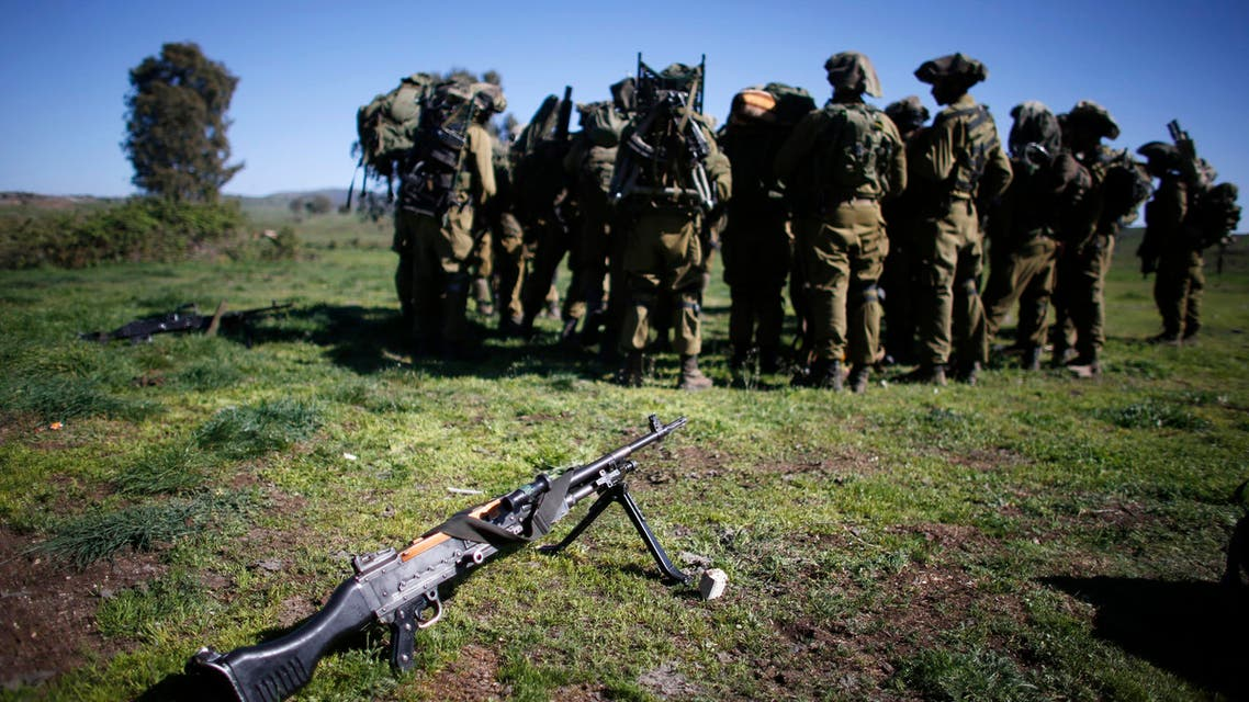 An FN MAG general-purpose machine gun is seen near Israeli soldiers during an exercise in the Israeli-occupied Golan Heights, near the border with Syria March 5, 2014. reuters