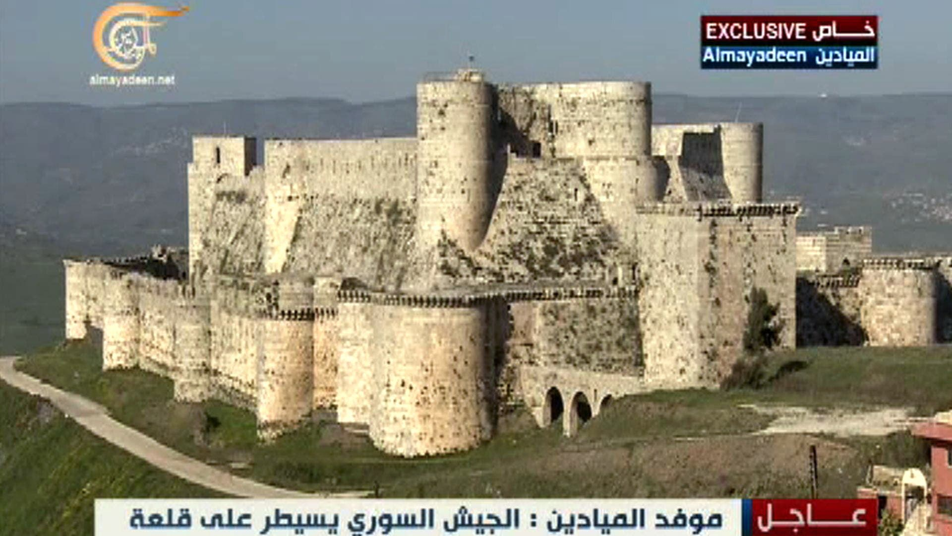 An image grab taken from Lebanon's Al-Mayadeen TV on March 20, 2014 shows the famed Crusader fort of Krak des Chevaliers, which according to Syrian state television, was taken by Syrian regime forces. (AFP)