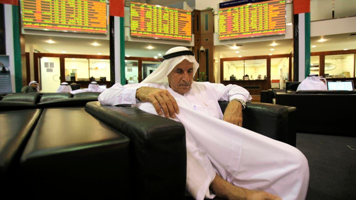 A broker sleeps at the Dubai Financial Market, Dec. 23, 2009.  (File photo Reuters)