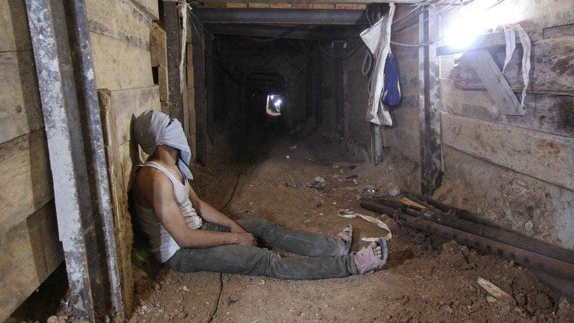 A tunnel worker rests inside a smuggling tunnel dug beneath the Gaza-Egypt border in the southern Gaza Strip. (Reuters)