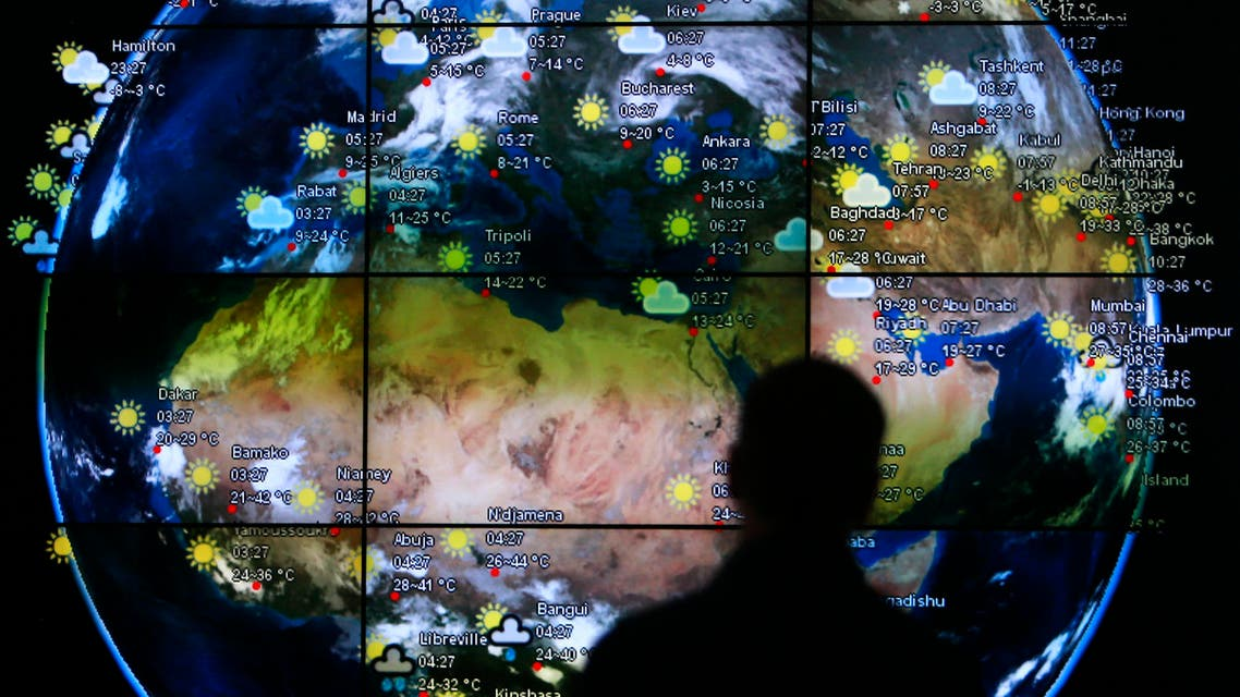 A visitor looks at a screen showing weather updates at the Kuala Lumpur International Airport in Sepang March 18, 2014. (Reuters)