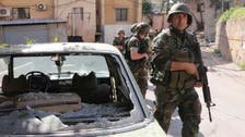 Pro-Assad gunmen clash with rivals in Beirut