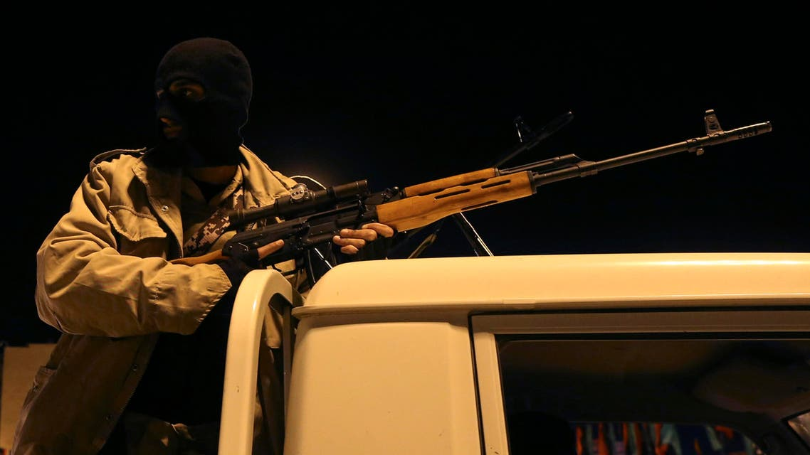 A member of a heavily-armed militia group is seen with his weapon in Benghazi on Feb. 18, 2014. (File photo: Reuters)