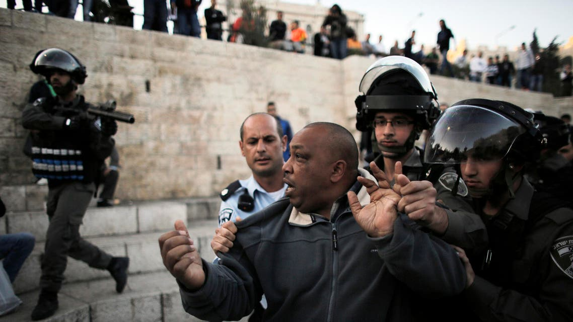 A Palestinian man is detained by Israeli border policemen during clashes near Damascus Gate at Jerusalem's old city March 22, 2014. reuters