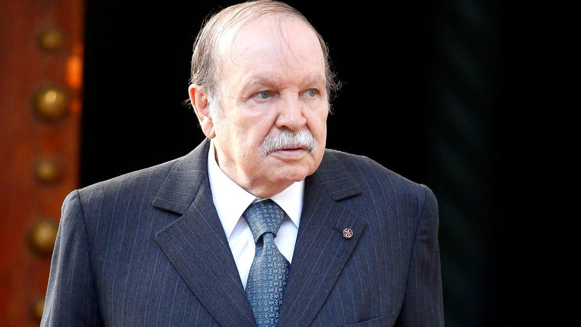 Algeria's President Abdelaziz Bouteflika walks towards Mali's Foreign Minister Tieman Hubert Coulibaly (not pictured) at the presidential palace in Algiers, April 10, 2013. (Reuters)