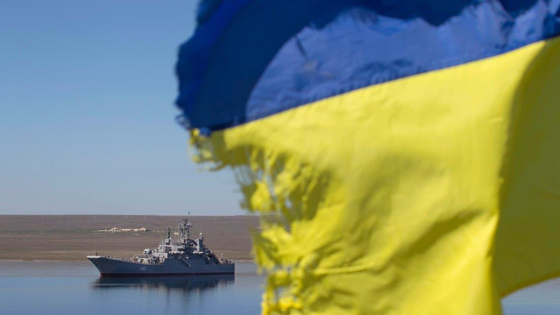 "A Ukrainian flag placed by a family member of a sailor on board the Ukrainian naval landing vessel ""Konstantin Olshansky"" is seen in the blockaded Donuzlav bay in Crimea March 23, 2014. reuters"