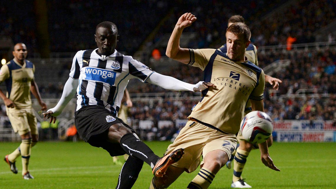 Newcastle United's Papiss Cisse (front L) is challenged by Leeds United's Scott Wootton (22) during their English League Cup soccer match at St James' Park in Newcastle, northern England September 25, 2013. (Reuters)
