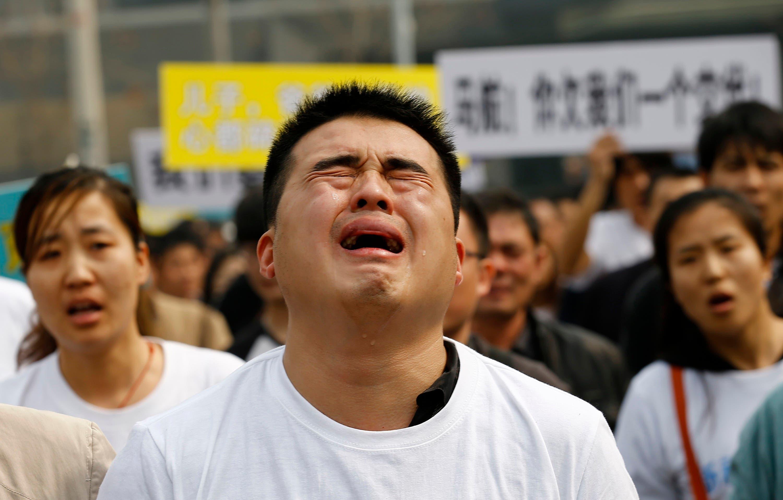 MH370 relatives erupt in grief